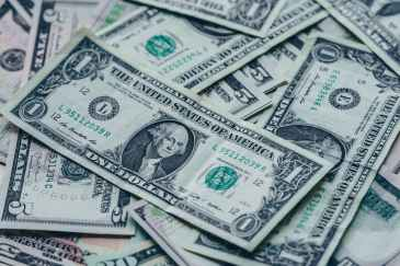 photography of one us dollar banknotes